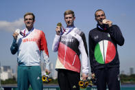 Silver medalist Kristof Rasovszky, from left, of Hungary, gold medalist Florian Wellbrock, of Germany, and bronze medalist Gregorio Paltrinieri, of Italy, pose for photos during a victory ceremony for the men's marathon swimming event at the 2020 Summer Olympics, Thursday, Aug. 5, 2021, in Tokyo, Japan. (AP Photo/Jae C. Hong)
