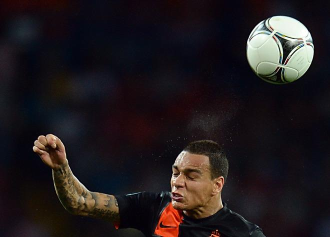 Dutch defender Gregory van der Wiel heads the ball during the Euro 2012 football championships match Portugal vs. Netherlands, on June 17, 2012 at the Metalist stadium in Kharkiv. Portugal won 2 to 1.          AFP PHOTO / FRANCISCO LEONGFRANCISCO LEONG/AFP/GettyImages