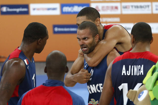 France's Tony Parker, center celebrates with his teammates, after their victory over Spain in their EuroBasket European Basketball Championship semifinal match in Ljubljana, Slovenia, Friday, Sept. 20, 2013. (AP Photo/Darko Bandic)