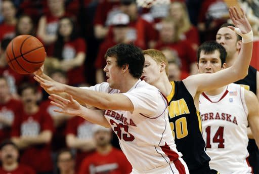 Nebraska's Mike Fox (33) is pressured by Iowa's Aaron White, center, as Nebraska's Christopher Niemann (14) trails behind in the first half of their NCAA college basketball game in Lincoln, Neb., Wednesday, Feb. 29, 2012. (AP Photo/Nati Harnik)