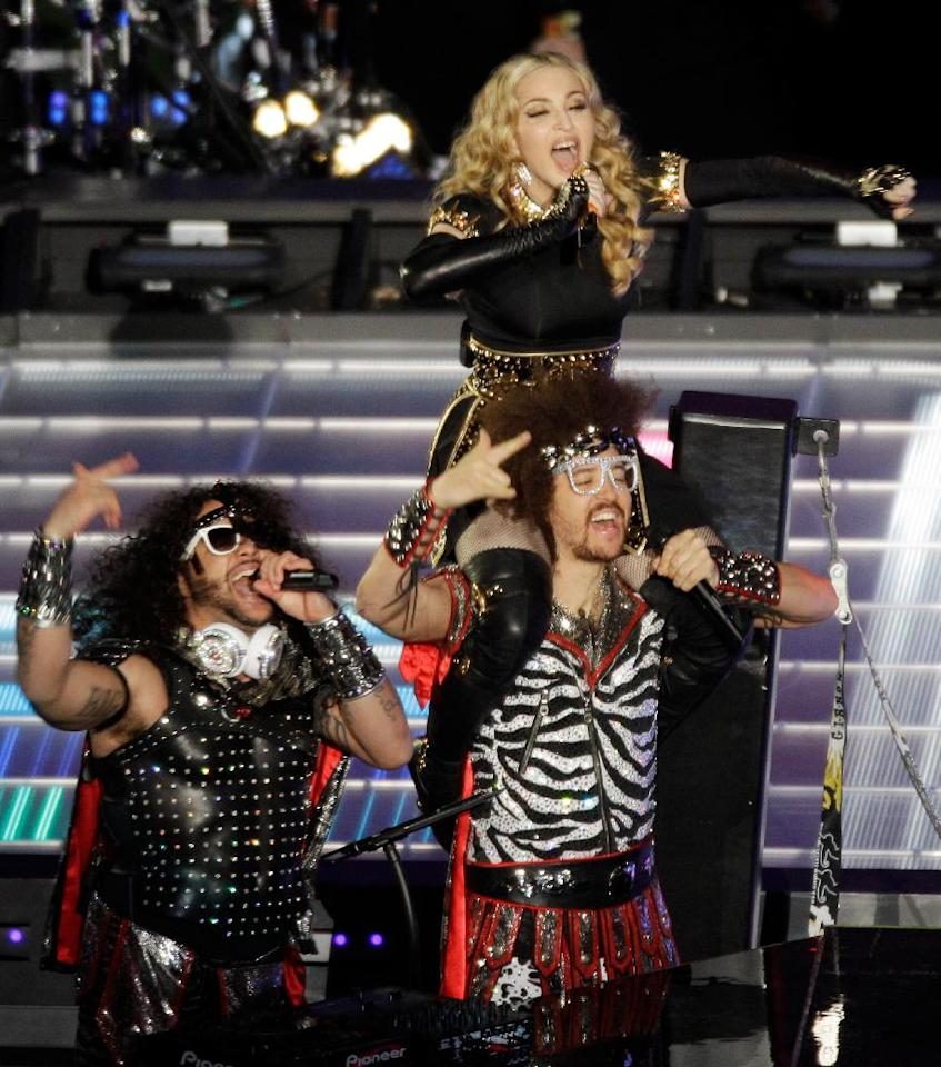 Madonna performs with LMFAO during halftime of the NFL Super Bowl XLVI football game between the New York Giants and the New England Patriots, Sunday, Feb. 5, 2012, in Indianapolis. (AP Photo/Charlie Riedel)