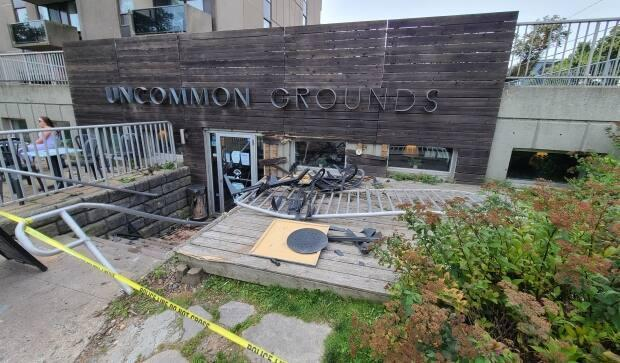 The Uncommon Grounds on South Park Street in Halifax was taped off Sunday afternoon after a car crashed into the front stairwell earlier that morning. (Haley Ryan/CBC - image credit)