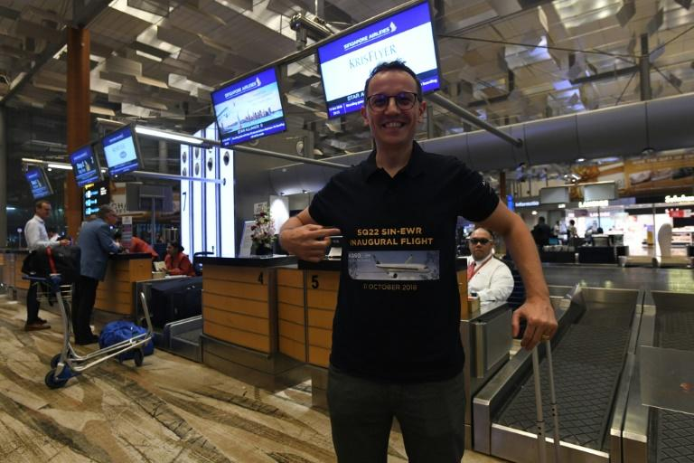 "Have T-shirt, will fly: Pier Messaggio is part of a group called ""First to Fly"" whose members have been on all Singapore Airlines' inaugural flights"