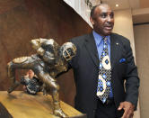 """FILE - In this Tuesday, March 27, 2012, file photo, a new award to honor college football's top return specialist is announced by 1972 Nebraska Heisman Trophy winner Johnny Rodgers at a news conference in Omaha, Neb. The Johnny """"The Jet"""" Rodgers Award is named for Rodgers, who is widely regarded as one of the top punt and kick returners in college football history. Rodgers' electrifying 72-yard punt return for a touchdown was the signature play of a rare game that lived up to """"Game of the Century"""" billing, helping No. 1 Nebraska defeat No. 2 Oklahoma 35-31 in the 1971 classic. Fifty years later, Rodgers still gets asked about the play. (AP Photo/Nati Harnik, File)"""