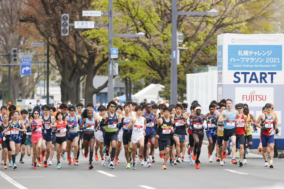 Runners start at the Sapporo challenge half-marathon held as a Tokyo 2020 Olympics test event in Sapporo, northern Japan, Wednesday, May 5, 2021. (Masanori Takei/Kyodo News via AP)
