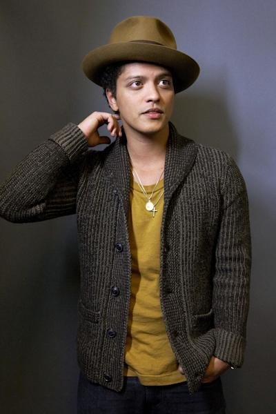 "FILE - This Nov. 5, 2012 file photo shows American singer-songwriter Bruno Mars posing for a portrait in New York. Mars is releasing his sophomore album, ""Unorthodox Jukebox,"" featuring Grammy-winning jazz singer Esperanza Spalding and production and songwriting work by Mark Ronson, Jeff Bhasker, Diplo, Paul Epworth, Emile Haynie and the Smeezingtons, the production trio that includes Mars, Philip Lawrence and Ari Levine. (Photo by Dan Hallman/Invision/AP, file)"
