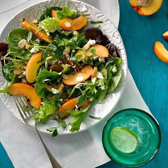 <p>This healthy side salad recipe follows one of the essential formulas for great salads: tossing bitter greens with sweet fruit, crunchy toasted nuts and salty cheese. Melons are a good alternative to the stone fruit later in the summer, or try dried apricots during the winter months.</p>