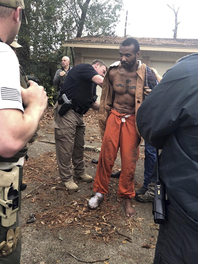 FILE - This Feb. 3, 2019 photo released by the Conroe Police Department shows Cedric Marks being captured after nine-hour manhunt that began when he escaped from a prisoner transport van in Conroe, Texas. A private prisoner transport company has told Texas officials it is shutting down after an MMA fighter accused of two murders escaped from its van last week. (Conroe Police Department via AP)
