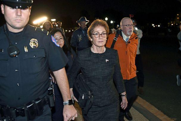 PHOTO:Former US Ambassador to Ukraine Marie Yovanovitch flanked by lawyers, aides and Capitol police, leaves the Capitol, Oct. 11, 2019. (Olivier Douliery/AFP via Getty Images)