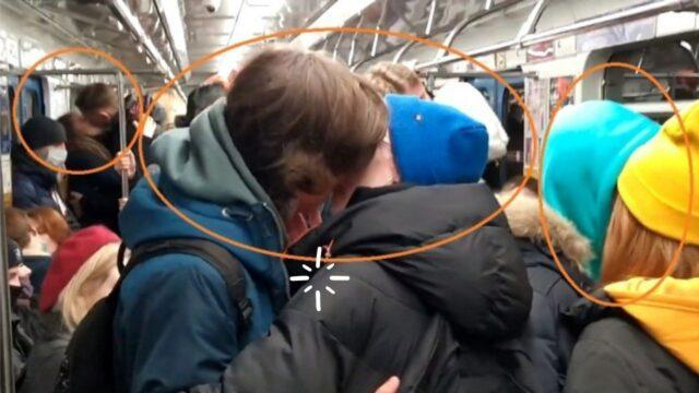 Couples kissing in Yekaterinburg Metro, Russia as a symbol against COVID-19 restrictions