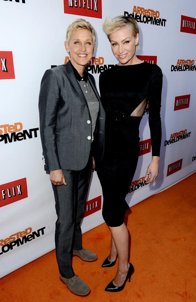"LOS ANGELES, CA - APRIL 29:  Comedienne Ellen Degeneres (L) and actress Portia de Rossi arrive at the premiere of Netflix's ""Arrested Development"" Season 4 at the Chinese Theatre on April 29, 2013 in Los Angeles, California.  (Photo by Kevin Winter/Getty Images)"