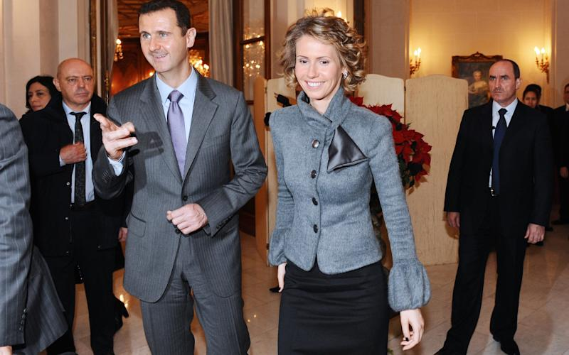 Syrian President Bashar al-Assad and his wife Asma - Credit: AFP