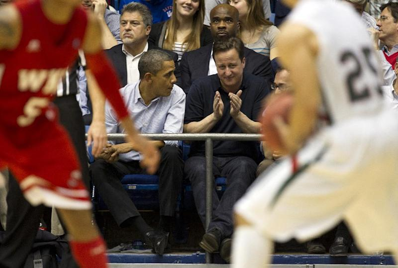 President Barack Obama and Britain's Prime Minister David Cameron attend the Mississippi Valley State versus Western Kentucky, first round NCAA tournament basketball game, Tuesday, March 13, 2012, at University of Dayton Arena, in Dayton, Ohio. (AP Photo/Carolyn Kaster)