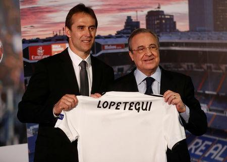 Soccer Football - Real Madrid present new coach Julen Lopetegui - Santiago Bernabeu, Madrid, Spain - June 14, 2018 New Real Madrid coach Julen Lopetegui poses with the shirt with president Florentino Perez during the presentation REUTERS/Juan Medina