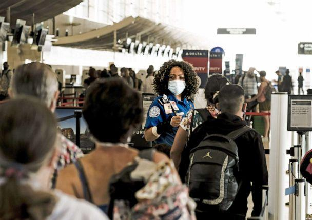 PHOTO: A Transportation Security Administration (TSA) agent guides travelers at a checkpoint in the Detroit Metropolitan Wayne County Airport (DTX) in Romulus, Mich., June 12, 2021. (Matthew Hatcher/Bloomberg via Getty Images, FILE.)