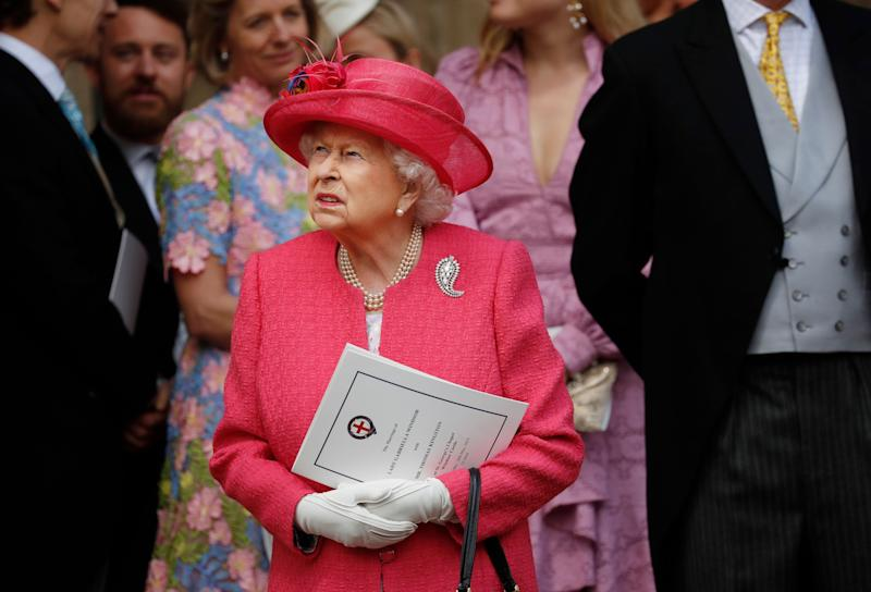 Queen Elizabeth II leaves after the wedding of Lady Gabriella Windsor and Thomas Kingston at St George's Chapel in Windsor Castle.