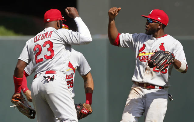 The Cardinals outfield hasn't had many reasons to celebrate in 2018. (AP Photo/Jim Mone)