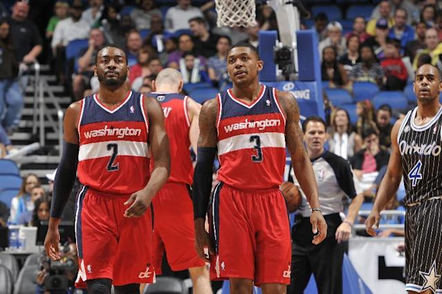 ORLANDO, FL - MARCH 14: John Wall #2 and Bradley Beal #3 of the Washington Wizards look on against the Orlando Magic during the game on March 14, 2014 at Amway Center in Orlando, Florida. (Photo by Fernando Medina/NBAE via Getty Images)