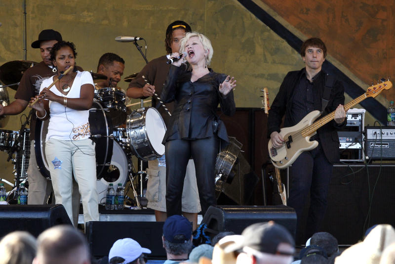 Cyndi Lauper, center, performs at the New Orleans Jazz and Heritage Festival in New Orleans, Thursday, May 5, 2011. (AP Photo/Patrick Semansky)
