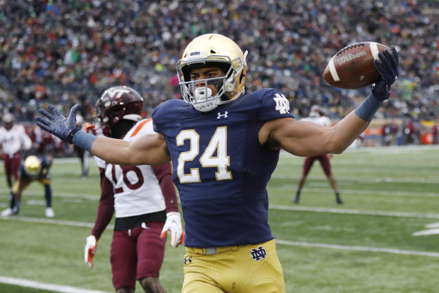 Notre Dame tight end Tommy Tremble (24) runs into the end zone for a after a 4-yard pass reception during the first half of an NCAA college football game against Virginia Tech, Saturday, Nov. 2, 2019, in South Bend, Ind. (AP Photo/Carlos Osorio)