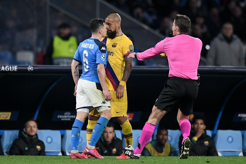 Arturo Vidal of Barcelona argues with Mario Rui of SSC Napoli during the UEFA Champions League Round of 16 match between Napoli and Barcelona at Stadio San Paolo, Naples, Italy on 25 February 2020. (Photo by Giuseppe Maffia/NurPhoto via Getty Images)
