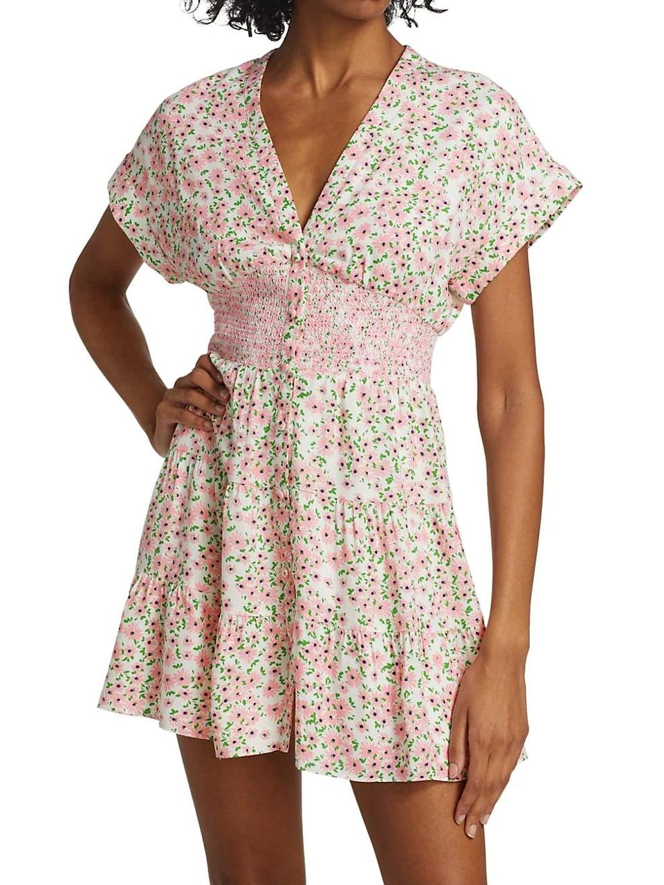<p>This <span>Alice + Olivia Keela Floral Print Smocked Button-Front Dress</span> ($330) will make you look cute, feminine and preppy.</p>