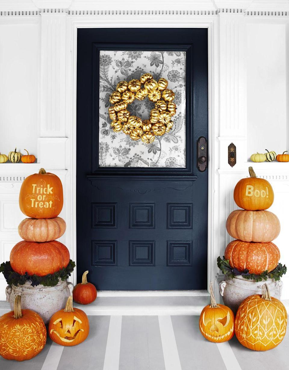 """<p>Wow trick-or-treaters with a gilded wreath on the front door. First, snap up <span class=""""redactor-unlink"""">faux mini pumpkins</span> (they're lighter than the real deal!) and spray with <span class=""""redactor-unlink"""">metallic spray paint</span>. Once they're dry, attach pumpkins to a wreath form using hot glue.</p>"""