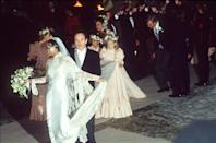 """<p>Diana Ross married for the second time to Norwegian shipping heir Arne Naess in 1986. Dressed in an elegant silk and lace column gown, Ross and her new husband were photographed leaving <a href=""""https://apnews.com/article/407a72dfcdaa84e1f6198006a8279b0f"""" rel=""""nofollow noopener"""" target=""""_blank"""" data-ylk=""""slk:Romainmôtier, Switzerland's"""" class=""""link rapid-noclick-resp"""">Romainmôtier, Switzerland's</a> oldest church after the ceremony. </p>"""