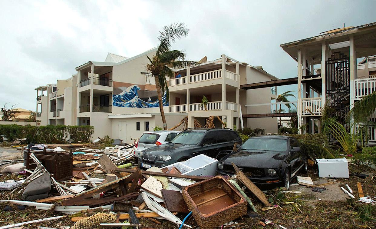 An outside view of Mercure hotel in Marigot on the Bay of Nettle on St. Martin on Sept. 6, after Hurricane Irma, and again on Feb. 28.