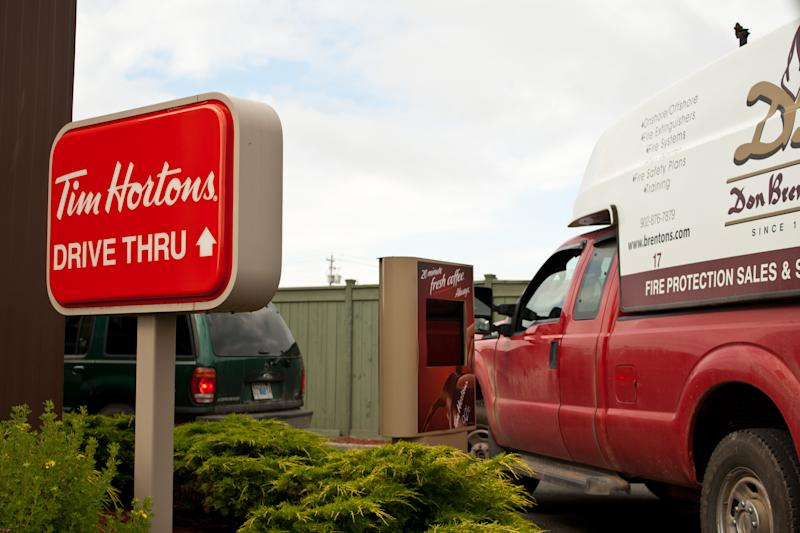 """Glace Bay, Nova Scotia Canada - August 2, 2011: A line up of vehicles waiting to be served at a local Tim Hortons coffee shop in Glaced Bay, Nova Scotia, Canada"""