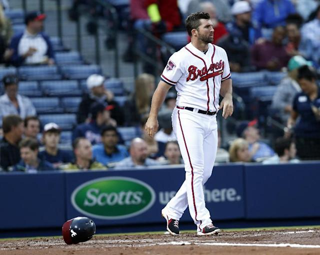 In this April 22, 2014, photo Atlanta Braves' Dan Uggla tosses his helmet after striking out to end the second inning of a baseball game against the Miami Marlins in Atlanta. Uggla's future in Atlanta was in question Sunday, July 12, 2014, after the Braves suspended the struggling second baseman for their final game before the All-Star break. The team announced the suspension on its Twitter feed, with no further explanation. Manager Fredi Gonzalez also declined to elaborate when asked about the punishment before the Braves' game against the Chicago Cubs. (AP Photo/John Bazemore)