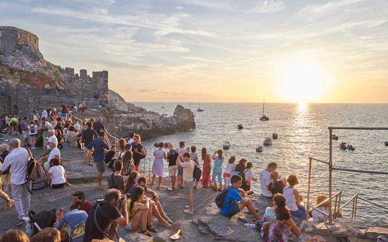 Sunset at the edge of the Old Town in Porto Venere, Italy. | Chiara Goia