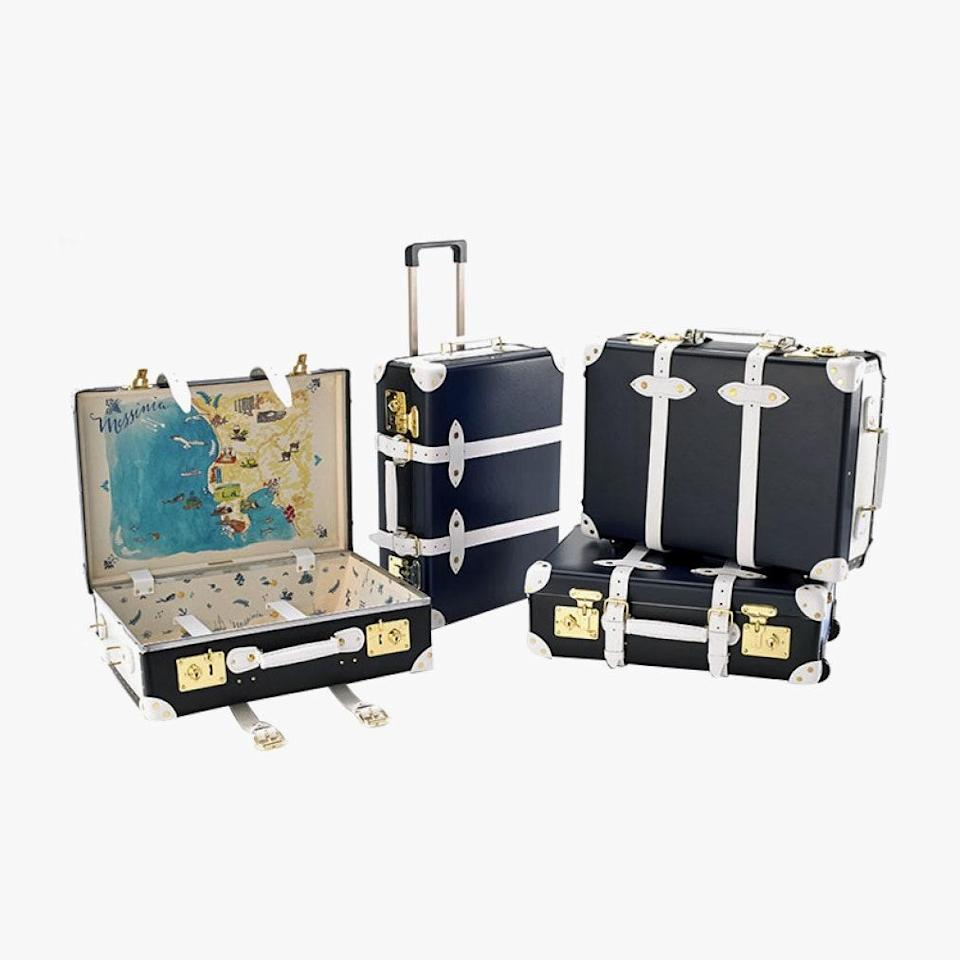 """Globe Trotter luggage makes cases and bags with a bygone safari feeling. They made for an obvious choice when it came to a collaboration with The Luxury Collection and Sofia Sanchez de Betak. The end product features a whimsical illustration of Mykonos, Athens, Santorini, and Messinia (where The Luxury Collection hotels can be found) on the insides of each case. $2005, THE LUXURY COLLECTION. <a href=""""https://www.luxurycollectionstore.com/product.aspx?the-luxury-collection-luggage-by-globe-trotter"""" rel=""""nofollow noopener"""" target=""""_blank"""" data-ylk=""""slk:Get it now!"""" class=""""link rapid-noclick-resp"""">Get it now!</a>"""