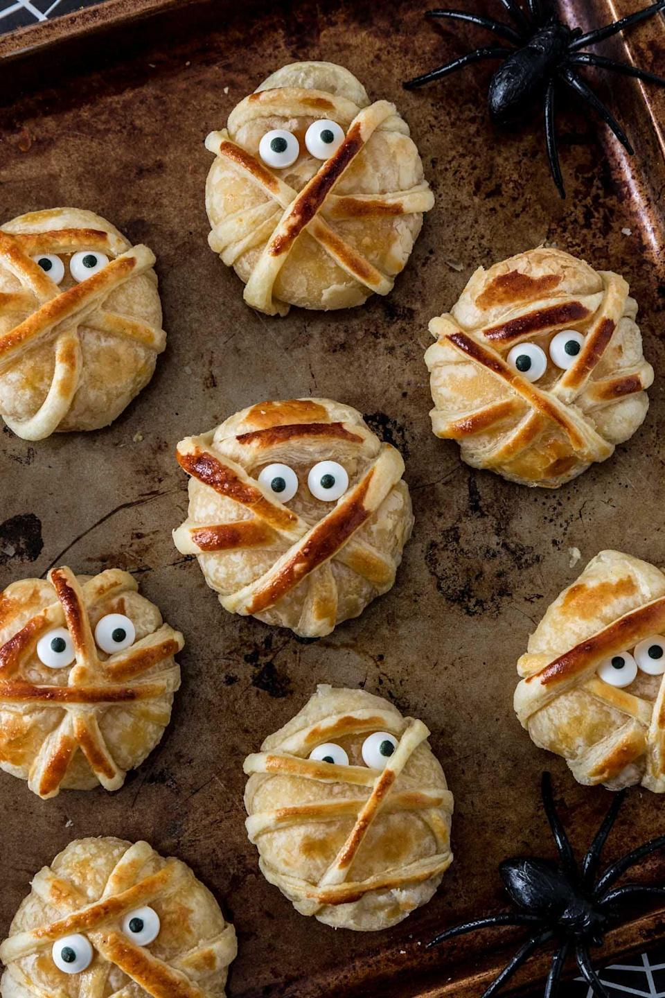 "<p>More cheese, please! These bite-size mummies will fill your plate with all the cheese you could ever dream of. Made with puff pastry and mini Babybel cheese, these will be a hit. Add little eyeballs to make them complete.</p> <p><strong>Get the recipe:</strong> <a href=""https://www.oliviascuisine.com/baked-cheese-mummies/"" class=""link rapid-noclick-resp"" rel=""nofollow noopener"" target=""_blank"" data-ylk=""slk:baked cheese mummies"">baked cheese mummies</a></p>"