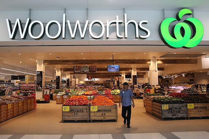 The front of a Woolworths store shows the supermarket sign and fruit and vegetable section in Sydney.