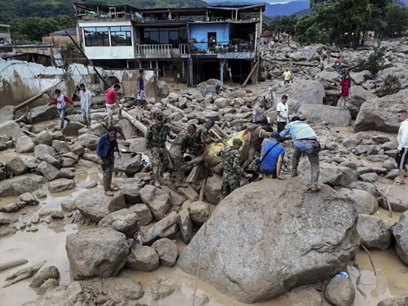 Heavy rains sent mud and debris crashing into houses overnight in the province of Putumayo: AFP/Getty