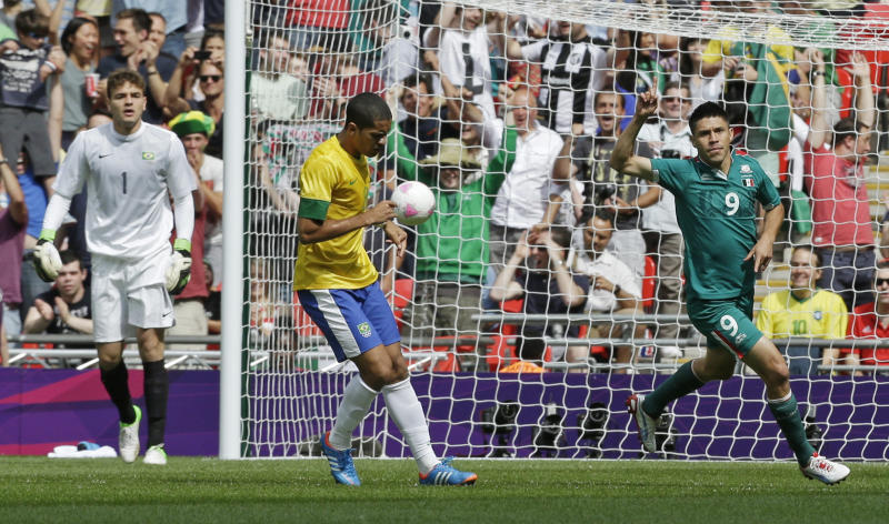 Mexico's Oribe Peralta (9) celebrates his goal in front of Brazil's Romulo (8) during the men's soccer final at the 2012 Summer Olympics, Saturday, Aug. 11, 2012, in London. (AP Photo/Hassan Ammar)