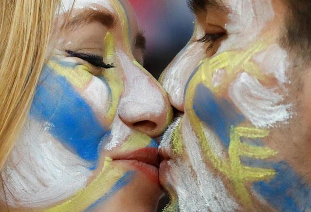 Soccer Football - Champions League Final - Real Madrid v Liverpool - NSC Olympic Stadium, Kiev, Ukraine - May 26, 2018 Real Madrid fans with painted faces kiss before the match REUTERS/Kai Pfaffenbach TPX IMAGES OF THE DAY