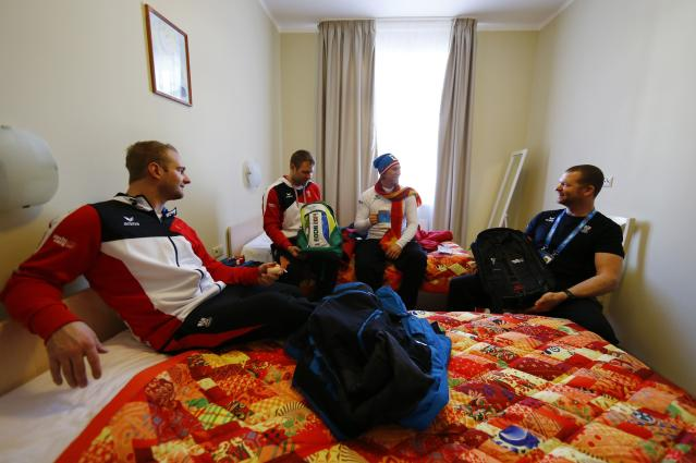 Austrian alpine skiers Georg Streitberger, Romed Baumann, Max Franz and Klaus Kroell, (L-R) pose for a photograph at their room in the Olympic rings at the Olympic athletes mountain village in Rosa Khutor near Sochi, February 4, 2014. Sochi will host the 2014 Winter Olympic Games from February 7 to 23. REUTERS/Kai Pfaffenbach (RUSSIA - Tags: SPORT SKIING OLYMPICS)