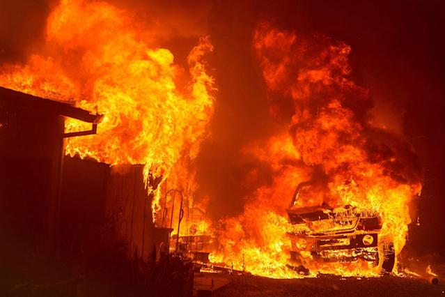 """<p>A car and house are engulfed in flames as the """"Wall Fire"""" burns through a residential area in Oroville, California on July 8, 2017. (Josh Edelson/AFP/Getty Images) </p>"""