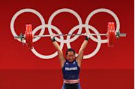 <p>Hidilyn Diaz of team Philippines competes during the women's weightlifting competition. She won the first-ever gold medal for the Philippines in any sport.</p>