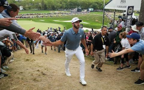 Dustin Johnson of the United States walks from the 17th green during the final round of the 2019 PGA Championship - Credit: Getty images