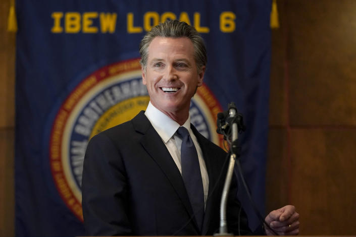 Gov. Gavin Newsom speaks to volunteers in San Francisco, Tuesday, Sept. 14, 2021. The recall election that could remove California Democratic Gov. Newsom is coming to an end. Voting concludes Tuesday in the rare, late-summer election that has emerged as a national battlefront on issues from COVID-19 restrictions to climate change. (AP Photo/Jeff Chiu)