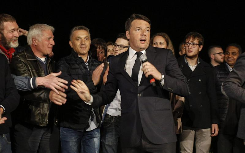 Matteo Renzi, centre, speaks after winning the Democratic Party's primary election - ANSA