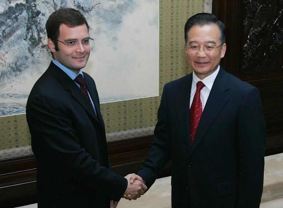 Rahul Gandhi (L), son of Rajiv and Sonia Gandhi head of India's ruling Congress Party meets with Chinese Premier Wen Jiabao (R) at Zhongnanhai in Beijing, 26 October 2007. Rahul is accompanying her mother Sonia on a five-day visit to China.   AFP PHOTO/Frederic J. BROWN (Photo credit should read FREDERIC J. BROWN/AFP via Getty Images)