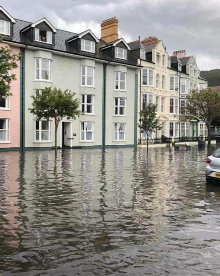 Water rises up to homes in Aberystwyth, Wales, on Monday. (Tom Kendall)