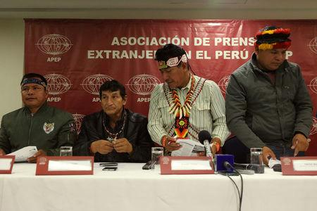 Chiefs of Amazonian tribes, Emerson Sandi, Alfonso Lopez, Aurelio Chino and Carlos Sandi attend a news conference with the foreign media in Lima, August 22, 2017. REUTERS/Guadalupe Pardo