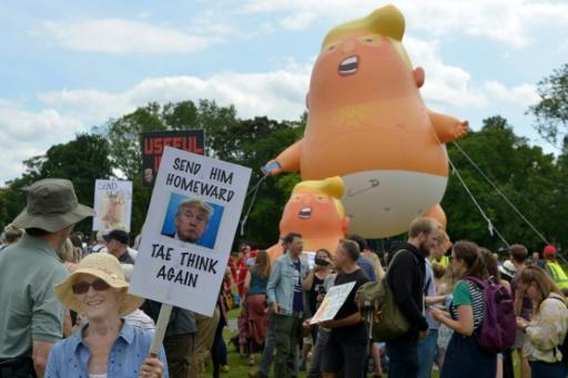 A giant balloon depicts US President Donald Trump as an orange baby at protests over his UK trip