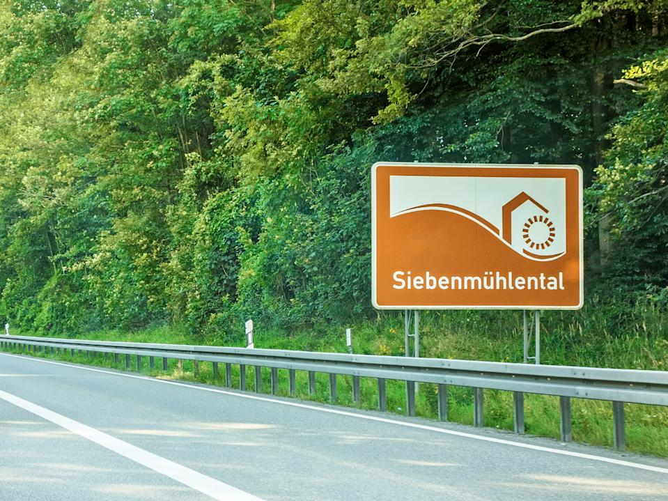 "road sign valley ""Siebenmuhlental"" at freeway, german Autobahn"