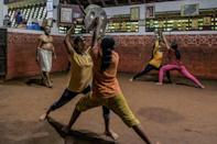 India's British colonial rulers banned the practice in 1804 but it survived underground before a revival in the early 20th century (AFP/Manjunath Kiran)